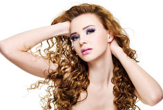 Beautiful expressive woman with  long curly hairs Stock Images