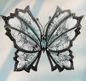 Beautiful exquisite blue butterfly decoration. Of precious materials royalty free stock photos