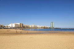 Beautiful extensive beach in Arrecife with the town in the background Royalty Free Stock Photography