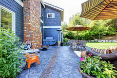 Beautiful exterior back yard of the blue house. stock photography