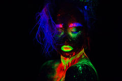 Beautiful extraterrestrial model woman with blue heair and green lips in neon light. It is portrait of beautiful model Stock Images