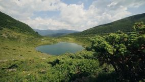 Beautiful extreme long shot of the mountain lake in the Carpathians mountains stock video
