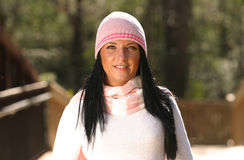 Beautiful Eyes. Young beautiful woman with pink hat and scarf Stock Photo