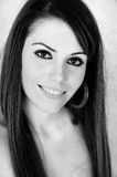 Beautiful Eyes. Female model head shot in black and white smiling large at the camera with eye contact Stock Image