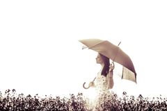 Beautiful eyes closed art woman with umbrella in meadow. The picture is digitally altered for an artificial style Stock Photography