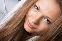 Beautiful eyes gaze. Gaze of pretty long-haired girl in white. facial closeup Royalty Free Stock Photo