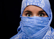 Beautiful eyes girl. Beautiful young woman coated by scarf Royalty Free Stock Photos
