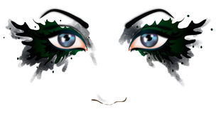 Beautiful eyes of a woman. Woman's eyes with a smudged green and black make-up surrounding each eye. Themes include beauty, mystery and fantasy Stock Photo