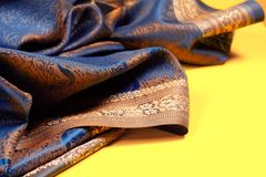 Beautiful fabric with golden lining Stock Images
