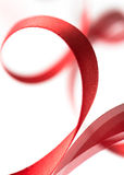 Beautiful fabric red ribbon on white Stock Photos