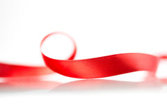 Beautiful fabric red ribbon on white. Background Stock Photos