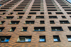 The beautiful facade of the new high-rise apartment building Stock Photos