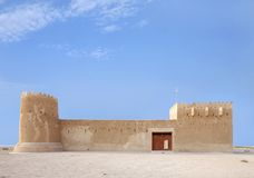 The beautiful facade of Zubarah fort, Qatar. The Zubarah Fort built in 1938 follows a traditional concept with a square ground plan with towers at the corner Stock Image