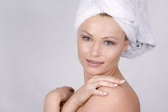 Beautiful face. Beautiful blond woman wearing blue towel and natural makeup Royalty Free Stock Images
