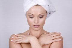 Beautiful face. Beautiful blond woman wearing blue towel and natural makeup Royalty Free Stock Photo