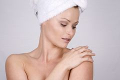 Beautiful face. Beautiful blond woman wearing blue towel and natural makeup Stock Photo
