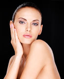 Beautiful   face of the adult woman with fresh skin Stock Images