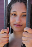Beautiful face behind bars Stock Photo