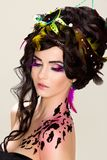 Beautiful face with bright makeup and feathers Royalty Free Stock Image