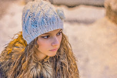 Beautiful Face closeup of Young Woman .Blond girl.Snow in background Royalty Free Stock Photography