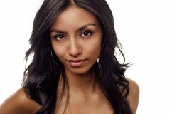 Beautiful face of exotic woman royalty free stock photography