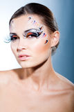 Beautiful face with extra long lashes. Fashion make-up with face art and extra long lashes Royalty Free Stock Photos