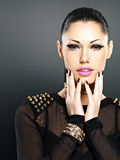 Beautiful face of fashion woman with black nails and bright make Stock Image