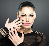 Beautiful face of fashion woman with black nails and bright make Royalty Free Stock Photo