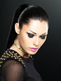Beautiful face of fashion woman with bright makeup. Stock Photos