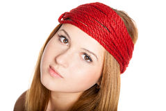 Beautiful face with freckles and red rope Royalty Free Stock Photography