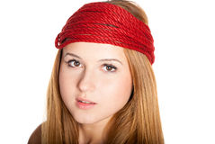 Beautiful face with freckles and red rope Stock Image