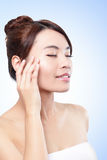 Beautiful face of girl applying moisturize cream Royalty Free Stock Photos