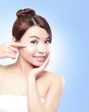 Beautiful face of girl applying moisturize cream Stock Image