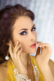 Beautiful face of a glamour woman with smoky eyes make-up. Beauty portrait young girl. Stock Image
