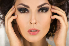 Beautiful face of a glamour woman with smoky eyes make-up. Beauty portrait young girl. Royalty Free Stock Photography