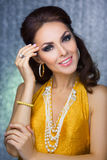 Beautiful face of a glamour woman with smoky eyes make-up. Beauty portrait young girl. Royalty Free Stock Photos