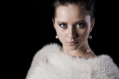Portrait of beauty woman in luxury white fur coat Royalty Free Stock Images