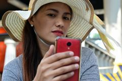 Beautiful Face of middle age woman wearing Sunday hat doing selfie photo with smart phone. stock photos