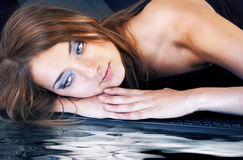 Beautiful face near with water Royalty Free Stock Image