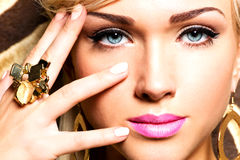 Beautiful Face Of Young Woman With Fashion Makeup Stock Image