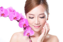 Beautiful face  with orchids Royalty Free Stock Photos