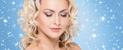 Beautiful face over Christmas background. Winter portrait of pretty blond woman. Beautiful face over Christmas background. Winter portrait of pretty woman Stock Photos