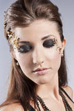 Beautiful Face.Perfect Makeup. Beautiful brunette in the studio. Unusual make-up Stock Photo