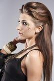 Beautiful Face.Perfect Makeup. Beautiful brunette in the studio. Unusual make-up Stock Photos