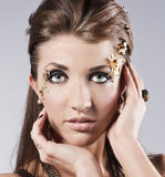 Beautiful Face.Perfect Makeup. Beautiful brunette in the studio. Unusual make-up Stock Photography