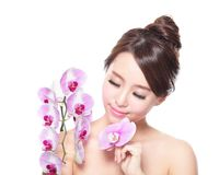 Beautiful face with pink orchids Stock Photography
