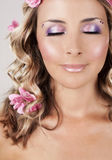 Beautiful face with pink roses Stock Image