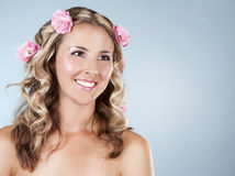 Beautiful face with pink roses Stock Photo
