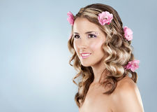 Beautiful face with pink roses Stock Photography
