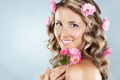 Beautiful face with pink roses Stock Images